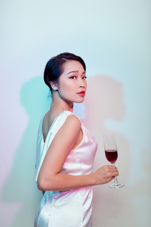 Party and holidays concept. Young asian woman  drinking cocktails and having fun