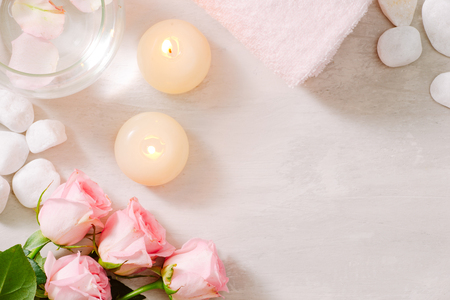 Spa settings with roses. Spa theme with candles and flowers on table. Stock Photo