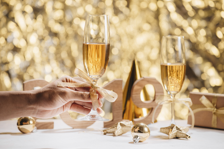 New Years Eve celebration background with pair of flutes, bottle of champagne Standard-Bild - 111112773