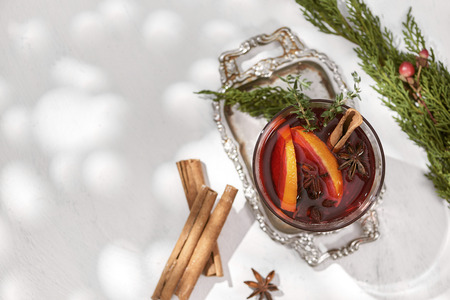 Glasses of mulled wine with orange and cinnamon. Selective focus