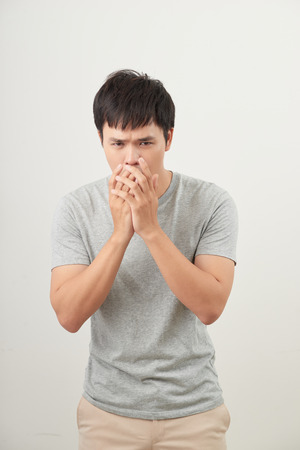 Mature man coughing on white background Stock Photo