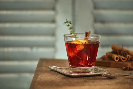 Christmas or Thanksgiving drink. Autumn and winter cocktail - grog, hot sangria, mulled wine with tea, lemon, rome, cinnamon, anise and other spices. Stock Photo