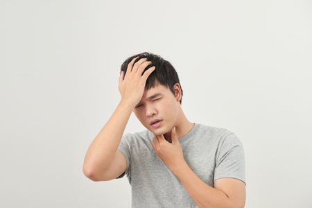 sick man has a sore throat isolated on a white background Stock Photo