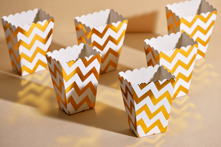 Empty paper golden Christmas cups for winter holidays meetings with friends with New Year