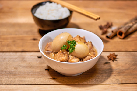Vietnamese caramelised pork with hard-boiled eggs braised in coconut water. Stock Photo