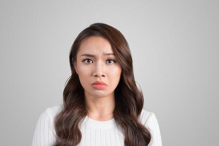Beautiful  asian young woman with sad face. Sad expression, sad emotion, despair, sadness Stock Photo