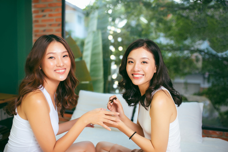 Two female friends do a manicure. The concept of hand care.