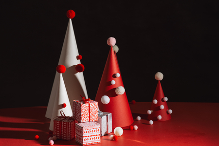 Creative Christmas tree made of paper on red background
