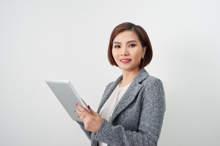 young business woman with digital tablet in office lobby