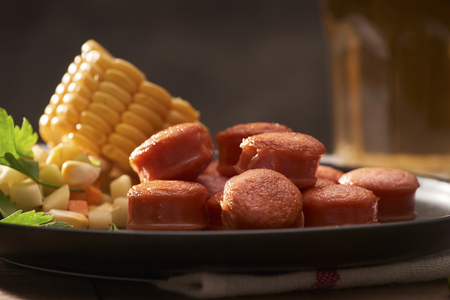 Grilled sausages with sauce ketchup on a wooden table Stockfoto