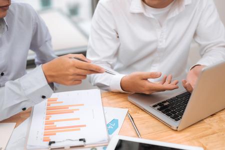 Businessman on online Financial Assessment. Team work in office 版權商用圖片