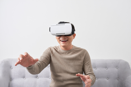 Surprised man using VR headset
