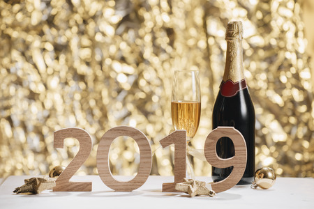 Sparkling New Year background, copy space. Champagne with decorations on New Years Day