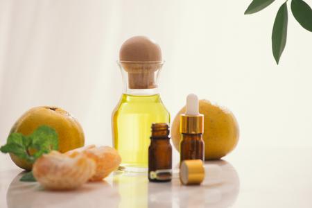 Tangerine oil on table on light background Archivio Fotografico - 113190682