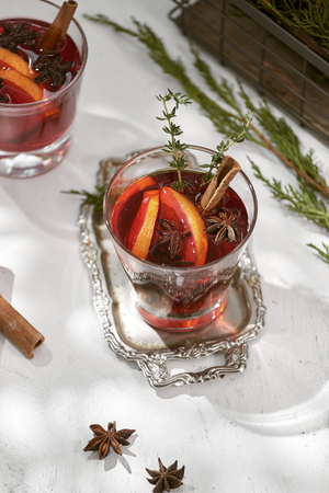 Delicious spicy hot mulled red wine with cinnamon, star anise and slice orange served in a carafe and glass for a cold winter evening or festive Christmas beverage Zdjęcie Seryjne