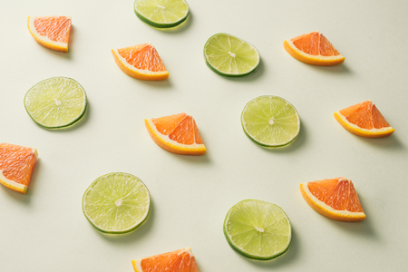 Composition with slices of citrus on color background