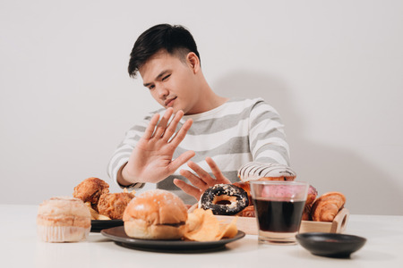 Young man in dieting and healthy eating concept Standard-Bild