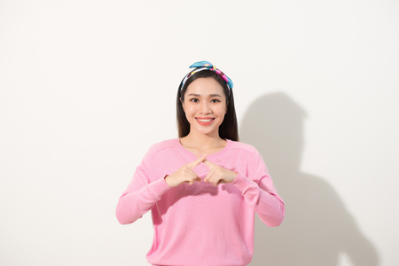 Pretty asian girl with fingers crossed to x shape, deny or forbidden sign, selected focus on hands Stock Photo
