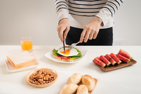 A man having breakfast with knife and fork Stock Photo