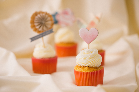 Tasty sweet pink cupcakes. Decorated dessert table Stock Photo