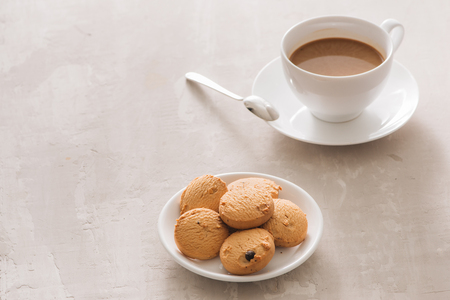 White cup of creamy coffee with butter cookies and stainless teaspoon isolated on white background, clipping path Stock fotó - 113658471
