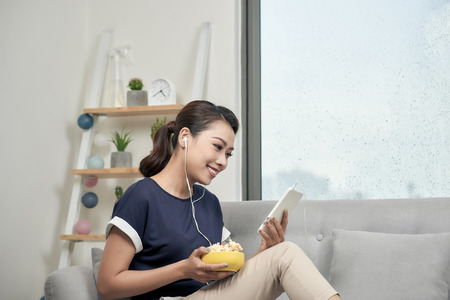 Young Asian woman enjoying music at home leisure and music concept Фото со стока