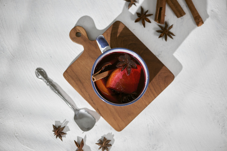 Cooking oranges in red wine with spices