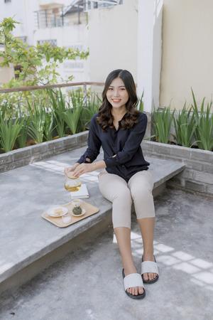 Young asian woman enjoying her comfortable terrace Stock Photo