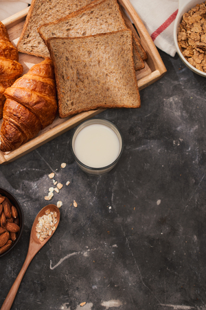 Breakfast with toast and croissant. milk in a glass bottle. Good start to the day. Good morning Zdjęcie Seryjne