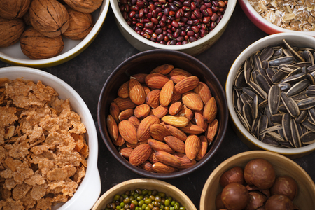 Different kinds of nuts in bowls.