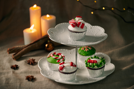 Christmas sweets: cupcakes closeup on a linen background.