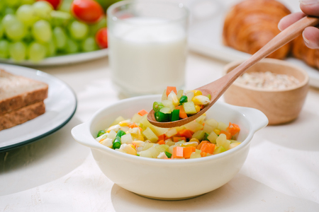 Light healthy Breakfast with oatmeal. Hercules, nuts, fruit, boiled eggs, bread. Tableware. Healthy food. Banco de Imagens - 114459633