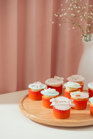 Many yummy cupcakes. Valentine sweet love cupcake on table on light background