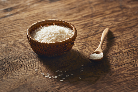 Jasmine  rice isolated on texture background.