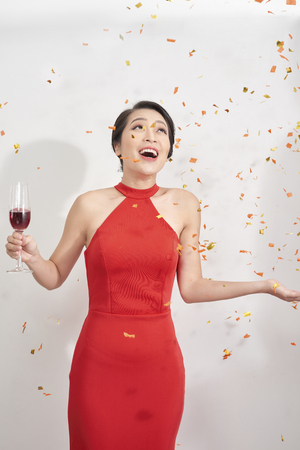International womens day concept. Carefree restless stunning posh classy luxurious elite trendy graceful beautiful pretty woman, star on the evening, dancing under rain made of confetti Stock Photo