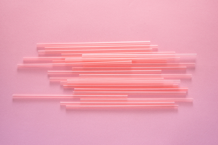 Drinking straws on bright pink background, top view Stok Fotoğraf