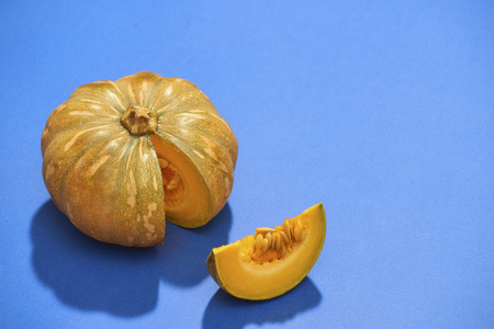 Raw pumpkins meat in isolated on blue