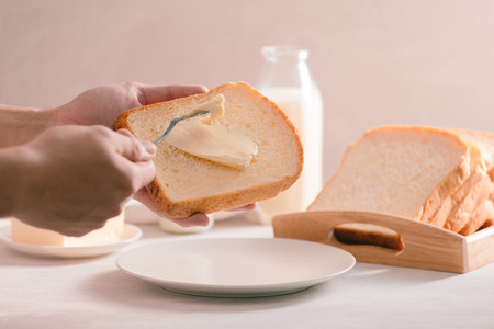 Sliced white bread and butter shot from a high angle view