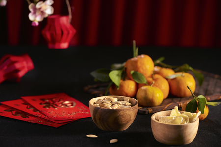 Concept image of the lunar new year - mandarin orange, jam and red packet. Text on envelop means Happy New Year and Happiness. Stockfoto