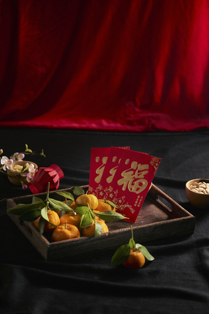 concept image of the lunar new year -mandarin orange and red packet