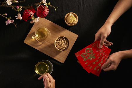 "Chinese Lunar New Year concept red envelope with Chinese character means happiness or good fortune, the chinese sentence means ""Wishing you prosperity� and ""May all your wishes come true�. Archivio Fotografico - 115294448"
