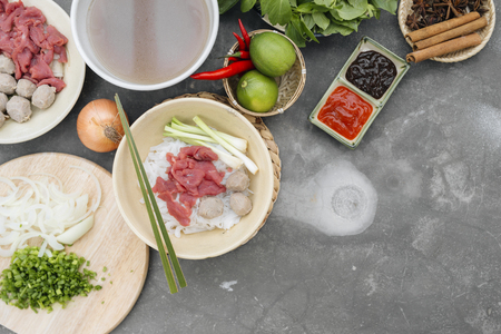 Assorted asian dinner with vietnamese noodle soup pho bo, Stock Photo