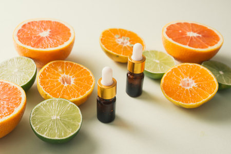 Brown Bottle with lemon, orange, tangerine and vitamin C. on white background. 免版税图像