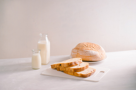 Delicious bread on cutting board on table