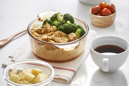 Lunch Rice topped with stir-fried chicken and broccoli, Coffee in the daytime
