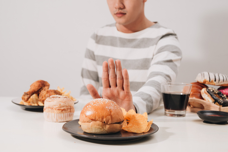 Young man in dieting and healthy eating concept Stock Photo