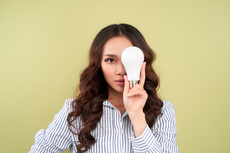 Green energy concept. Woman with led light bulb