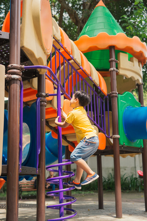 Kids playing with park play equipment