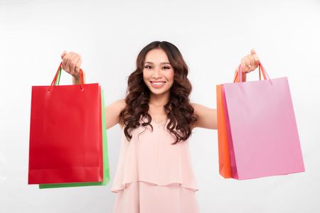 Happy shopping! young woman carrying shopping bags ,Shopping woman holding shopping bags while her feeling happy