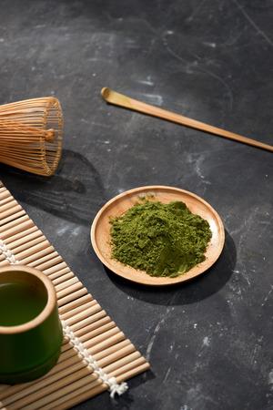 Organic Green Matcha Tea on wooden table, copyspace Reklamní fotografie